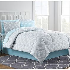 Transform your bedroom into a soothing sanctuary with the lovely Chandra Comforter Set. Adorned with an ikat medallion design in subtle blue, grey and white hues, the beautiful bedding instantly creates a light and airy ambiance in any room.