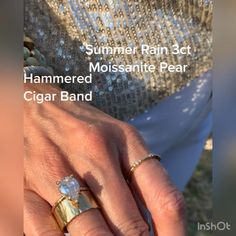 This summer rain is quickly becoming one of our best sellers! A 3 carat pear-shaped Moisanite engagement ring with a Hammered halo and a hammered band is the perfect combination of BoHo and traditional. Turning heads at every glance. Pear Diamond Engagement Ring, Pear Ring, Celebrity Engagement Rings, Cigar Band, Summer Rain, 3 Carat, Rings For Men, Men Rings, Teardrop Ring
