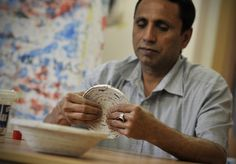 Like this Pakistani man, some asylum-seekers waiting for a final decision in Slovakia, spend their free time making crafts. This man makes a bowl using old newspaper. © UNHCR/B. Szandelszky #UNHCR #Slovakia #asylum