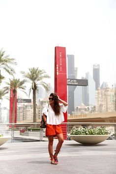 outfit-edited-shorts-pompom-sandals-white-blouse-dubai-mall