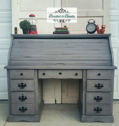 """Finished up my very first vintage roll top desk! Painted in a custom mix of General Finishes Milk Paint in Driftwood and Snow White, then distressed, black waxed and sealed with poly. Love!"" - Brushes to Beauty"