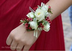 Corsage white roses and red wax flowers