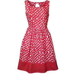"""This fitted party dress has a scooped neckline and a flattering gathered waistline. It's got special details like cute polka dot """"pebbles"""" and a key hole with button closure at the back. The fabric is made using the batik method in Ghana, by a women's cooperative called Global Mamas."""