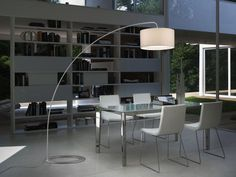 An Arc Lamp Illuminates The Dining Table  Dining Room And Glass Interesting Dining Room Floor Lamps Decorating Inspiration