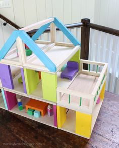 A DIY tutorial to build a modular dollhouse and free plans for dollhouse furniture.