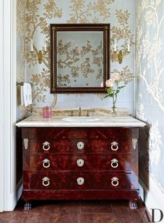 10 of 15 A vanity made from a Directoire commode furnishes the powder room of a Houston residence decorated by Elissa Cullman. The scenic Gracie wallpaper is hand-painted. Gracie Wallpaper, Powder Room Wallpaper, Wallpaper Ideas, Bathroom Wallpaper, Painted Wallpaper, Architectural Digest, Rooms Ideas, Scenic Wallpaper, Luxury Interior Design