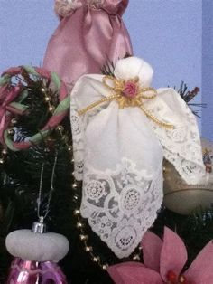 A handkerchief angel can be made with a cotton ball, wire, and ribbon without damaging the handkerchief. No cutting, no gluing. A flower or other embellishment may be added. Christmas Angels, Christmas Holidays, Christmas Crafts, Christmas Decorations, Christmas Ornaments, Handkerchief Crafts, Sewing Crafts, Sewing Projects, Memory Crafts