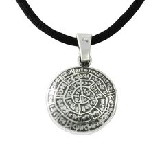 """One of the most famous mysteries of archeology, the Disc of Phaistos, was our """"guide"""" to the creation of an aesthetic pendant, made of pure silver.  The reverse of the pendant bears a Minotaur design, inspired by the silver stater of Knossos, dated from 425 B.C. Diameter: 2,5cm 17th century B.C., Phaistos, Crete Silver 999°"""
