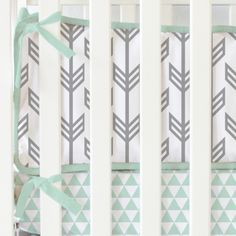 gray arrow crib bumpers with mint trim