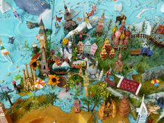 https://flic.kr/p/fq5tXp   Sara Drake - Europe detail from large 3D world map   Sara Drake - 3d illustrated world maps made from mixed media, including papier mache, balsa wood, acrylic paint, beads and wire. All details are hand made and to commission. Each map is personalised with the details of the client's own travels.