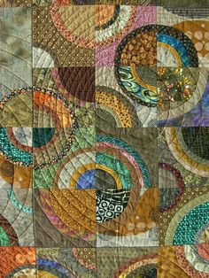 I love the ripple-style quilting superimposed over the drunkard's path blocks.