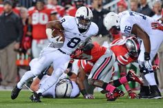 PENN STATE – FOOTBALL 2013 – Penn State vs Ohio State on October 26, 2013. Allen Robinson #8 of the Penn State Nittany Lions runs upfield after a pass reception in the first quarter against the Ohio State Buckeyes at Ohio Stadium on October 26, 2013 in Columbus, Ohio. Ohio State defeated Penn State 63-14. (Photo by Jamie Sabau/Getty Images)