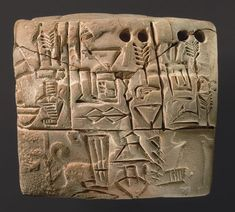 Sumerian / Uruk administrative tablet with cylinder seal impression of a male figure, hunting dogs, and boars C.3000BC.
