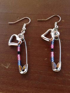 Safety pin dangle earrings are decorated with beads in the colors of the Black Trans Pride flag. A heart charm is included to remind us to show love and solidarity with the Black Trans community. All sales benefit Trans Lifeline.  http://www.translifeline.org/  Trans Lifeline is a 501(c)3 non-profit dedicated to the well being of transgender people. We run a hotline staffed by transgender people for transgender people. Trans Lifeline volunteers are ready to respond to whatever ...