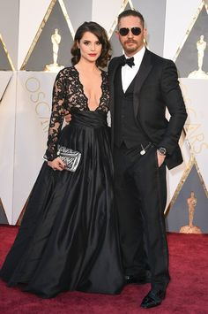 Tom Hardy in Gucci and Cutler and Gross Sunglasses  Leave it to Tom Hardy to bring a little (or a lot) of rebel style to the red carpet—the three-piece tux says classic gentleman but the sunglasses say badass.