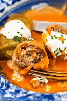 Russian Cabbage Rolls stuffed with extra lean beef, rice and veggies and baked in a creamy tomato sauce. Comfort food at its best. #SochiOlympicsFood