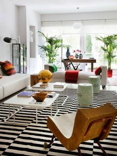 A black and white rug anchors this globally inspired house designed by Alfonso Merry del Val--image via Mix and Chic