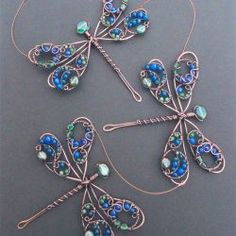 Triple Demoiselle Dragonfly Suncatcher - A decorative copper wire dragonfly hang. Triple Demoiselle Dragonfly Suncatcher - A decorative copper wire dragonfly hanging mobile featuring three of a rather special British species, the Beaded Dragonfly, Dragonfly Jewelry, Beaded Jewelry, Handmade Jewelry, Bead Crafts, Jewelry Crafts, Wire Jewelry Designs, Yarn Crafts, Sewing Crafts