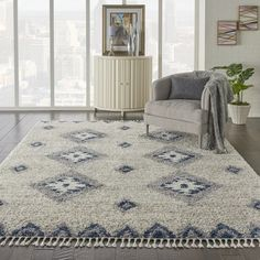 This Nourison Scandinavian Shag Medallions Area Rug features easy-care fibers with twisted fringe for an authentic tribal look and feel. This rug has a geometric medallion design in beige, ivory, and blue all with the casual comfort of a soft shag. Target Rug, Target Area Rugs, Nourison Rugs, Living Room Area Rugs, Rug Material, Indoor Rugs, Online Home Decor Stores, Beige, Gray