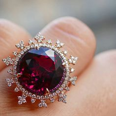 Dreamy Tsarina Fire Flake ring by @nadineaysoyjewellery set in rose gold with 7ct rhodolite, pink sapphires and framed by intricate diamond motif. Such a sweet and delicate snowflake halo on this deep garnet. ●◇● #blissfromparis #GoldJewelleryDelicate