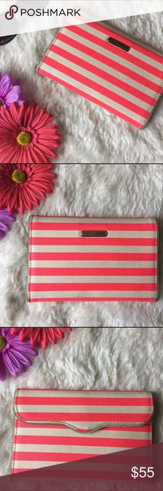 Rebecca Minkoff Parker Passport Wallet Pink Stripe Pink and white stripe canvas wallet. Leather interior. Some blemishes interiorly but overall in excellent condition. Travel in style with a striped passport wallet crafted with a sculpted, zipper-trimmed flap and interior organization for fuss-free globetrotting. Magnetic-snap closure. Interior passport and currency pockets; sixteen card slots; removable zip pouch. Last photo is a stock photo but not the actual color. Coated canvas. Smoke…