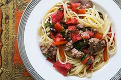 Pasta served with Italian sausage, roasted red bell peppers, olives, capers, fresh tomato and basil.