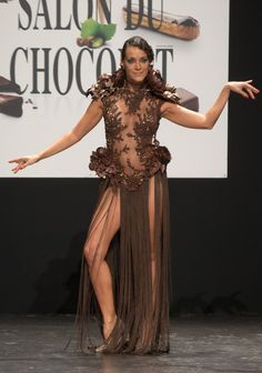 French TV Host Karine Lima models a chocolate embellished dress TV personality Karine Lima becomes a living sculpture._Oct. 2015_Dresses at the Paris chocolate show – in pictures