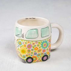 This Van Folk Art Mug by Natural Life will have you smiling every time you drink from it! With an adorable vintage van design, this hand sculpted, ceramic mug is microwave and dishwasher safe. Pottery Painting, Ceramic Painting, Owl Mug, Animal Mugs, Van Design, Vintage Vans, Cute Mugs, Natural Life, Ceramic Mugs