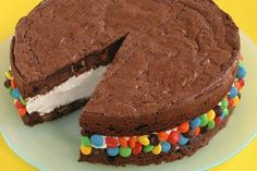 Icecream Sandwich - Easy and quick!     1 packet brownie mix  M's  Icecream    Make brownies as per instructions.  Invert one layer onto a cookie sheet, and spread vanilla ice cream on top, coming right to the edge (you can slightly soften the ice cream first).  Stick on candy.  Freeze for a while. Yummo!