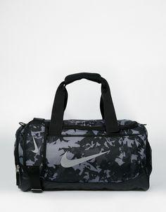 "Duffle bag by Nike Printed canvas Grab handles Adjustable shoulder strap External pocket Zip around opening Signature swoosh logo Wipe clean 100% Polyester H: 20cm/8"" W: 50cm/20"" D: 20cm/8"""