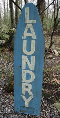 Salvaged ironing board turned sign