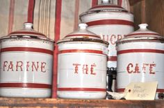 red and white enamel french canisters