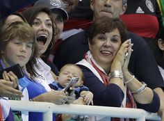Boomer slept through his father's final stand on the podium, but Johnson and Phelps' mother were ecstatic