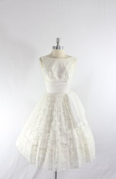 too lacy! 1950s Vintage Wedding Dress - Short White Lace Full Skirt with Matching Bolero Jacket Wedding Frock. $240.00, via Etsy.