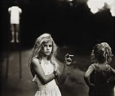 Sally Mann - Candy Cigarette, 1989. This is actually one of my favorite photos in existence.