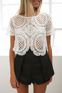 This top would be cute with black capris, these shorts are too short for me.