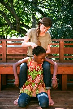 andrew and carissa. great story of a 23 year old couple who adopted this 6 year old girl from uganda.