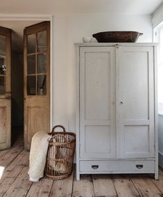 Wooden Armoire / Cabinet Wicker Basket Wooden French Doors Entryway Storage for Mudroom Modern Farmhouse Vintage Antique Furniture - March 09 2019 at Old French Doors, Vintage Armoire, Wide Plank Flooring, Plank Walls, Laminate Flooring, Home And Deco, Interior Styling, Interior Decorating, Armoire Decorating