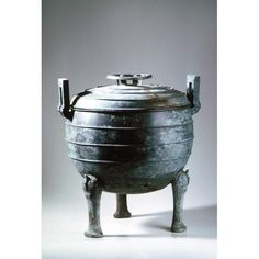 Asian Art Museum Online Collection Ritual vessel (ding) with lid Place of Origin: China Date: approx. 500-400 BCE Historical Period: Warring States Period (approx. 480-221 BCE), Eastern Zhou dynasty (771-255 BCE) Materials: Bronze Dimensions: H. 17 in x W. 15 in x D. 13 3/4 in, H. 43.2 cm x W. 38.1 cm x D. 34.9 cm Credit Line: The Avery Brundage Collection Department: Chinese Art Collection: Metal Arts Object Number: B60B1055 On Display: No Zhou Dynasty, Warring States Period, Asian Art Museum, Online Collections, Art Object, Chinese Art, Metal Art, Objects