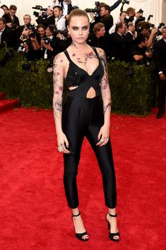Cara Delevingne brought a dose of edge to the 2015 Met Gala red carpet with this Stella McCartney cutout jumpsuit and a collection of temporary tattoos.