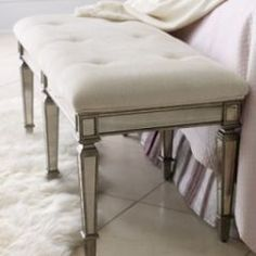love the little foot of the bed stools