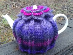 'Hot Hibiscus Tea Cozy' - subdued version. Made using Moda Vera Bouvardia 'Sweet Pea'. Tea Cozy pattern here; http://www.ravelry.com/patterns/library/hot-hibiscus-tea-cozy Flower I used was this one; http://olavas.blogspot.pt/2012/10/flower-pattern-in-english-o.html