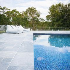 to this amazing pool completed with Belgium Blue Limestone from Outdoor Pavers, Pool Pavers, Outdoor Flooring, Pool Landscaping, Patio, Limestone Pavers, Pool Coping, Pool Designs, Landscape Design