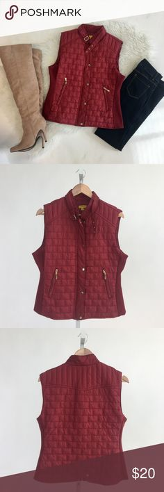 Burgundy Quilted Vest Burgundy nylon vest featuring a quilted design and ribbed fabric at sides. Zip closure with buckle at neck. Zipper and button front. Side outer pockets with zipper. Please carefully review each photo before purchase as they are the best descriptors of the item. My price is firm. No trades. First come, first served. Thank you! :) Daisy Jackets & Coats Vests