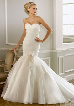 Mori Lee by Madeline Gardner (1602) mermaid-style dress  - Sweetheart neckline  - Gown features beading and button detail down back.