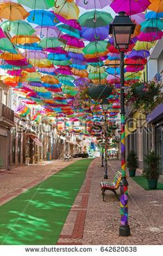 sky of colorful umbrellas. Street with umbrellas.Umbrella Sky Project in Agueda, Aveiro district, Portugal.Street decorated with colored umbrellas, Agueda. Umbrella Street, Umbrella Art, Beautiful Streets, Beautiful Places, Places To Travel, Places To Visit, Umbrella Decorations, Street Art, Colorful Umbrellas