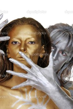 gold and silver | Gold and silver women body painted - Stock Image