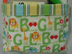 Fabric Basket Tutorial. Need a way to organize your kids' rooms? Learn how to sew a basket with this Fabric Basket Tutorial. They make great baby shower gifts!