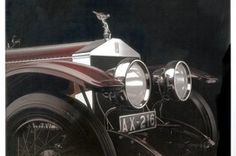 1914 Rolls-Royce Silver Ghost. A motoring icon with a a hush quiet engine, elegant lines, high-gloss finish, distinctive grille, silver-goddess hood ornament, and a top speed of 78 mph (fast by 1914 standards)