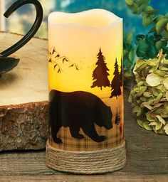 Bear LED Candle - A flickering LED light glows behind wildlilfe silhouettes on the twine-wrapped, flameless wax Bear LED Candle with a timer. Uses three AAA batteries (not included). Rustic Cabin Decor, Lodge Decor, Country Decor, Rustic Cabins, Log Cabins, Rustic Wood, Black Bear Decor, Black Forest Decor, Led Candle Lights